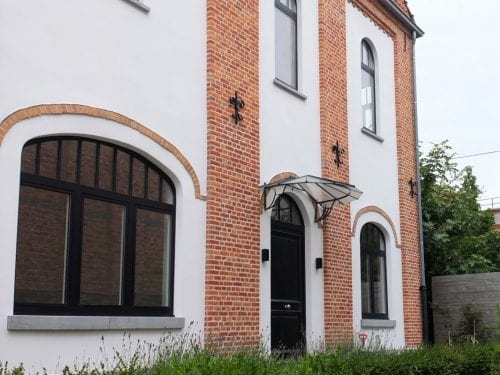 gevelrenovatie met pleister en gevelsteen in Gent